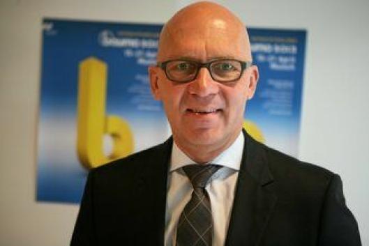 KJØPEGLAD: Styreformann og adm. direktør Klaus Dittrich i Messe München.
