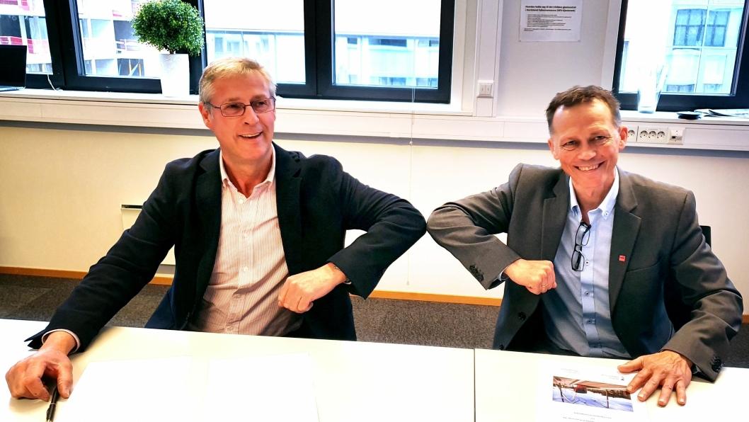 Direktør Roger Skoglie i Bybanen Utbygging (t.v.) og distriktsleder Erlend Bygnes i Veidekke Bygg Bergen.