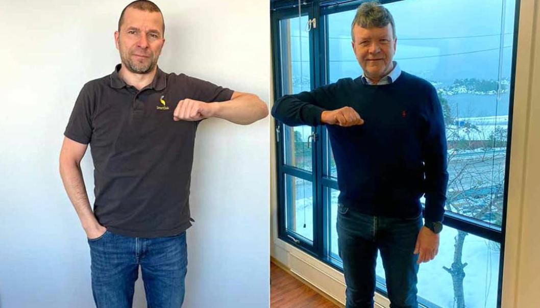 Daglig leder av SmartDok, Bjørn Tore Hagberg, og styreleder i MEF, Arnstein Repstad, tar en digital covid-19-vennlig handshake som bekreftelse på at partene nå skal samarbeide om HMS/KS.